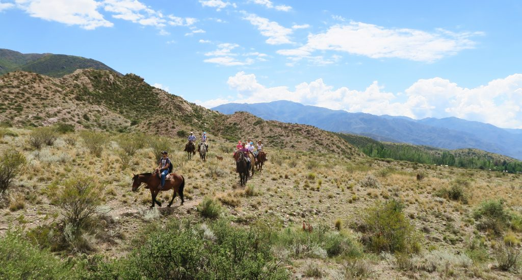 Group of horseback riders in the Andes, Mendoza, Argentina