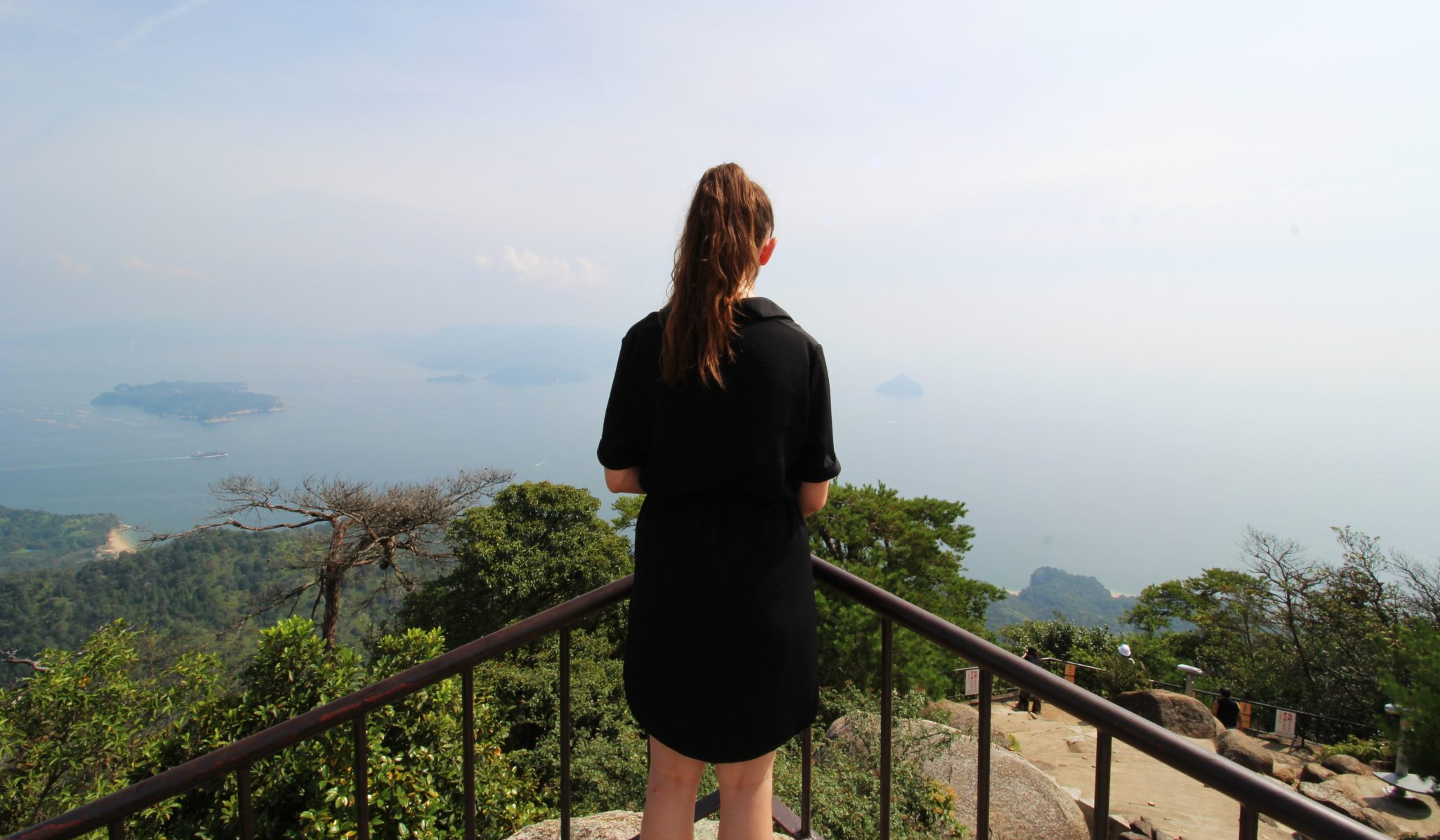 Girl overlooking view from Miyajima Island