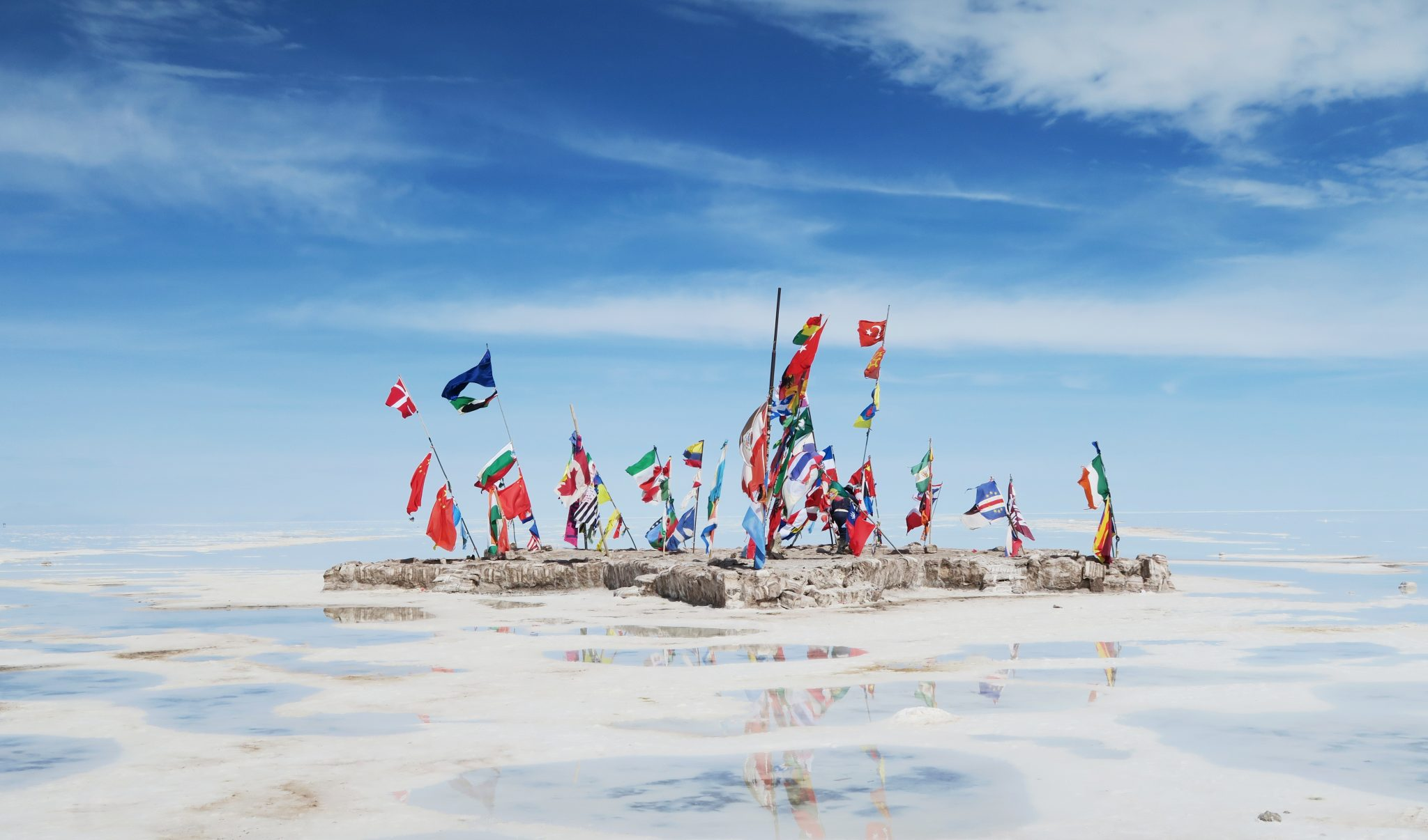 Coloured flags on Uyuni salt flats