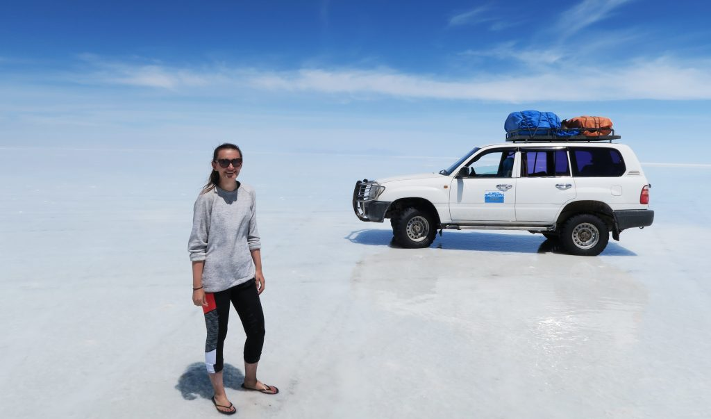 Girl and car on Uyuni salt flats