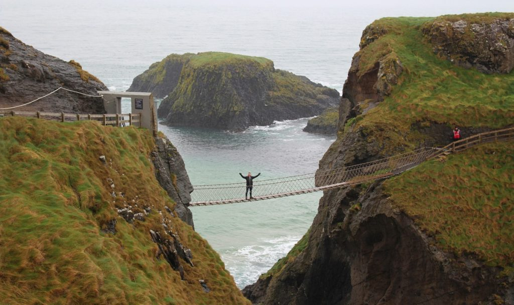 Man Crossing Carrick-A-Rede-Bridge