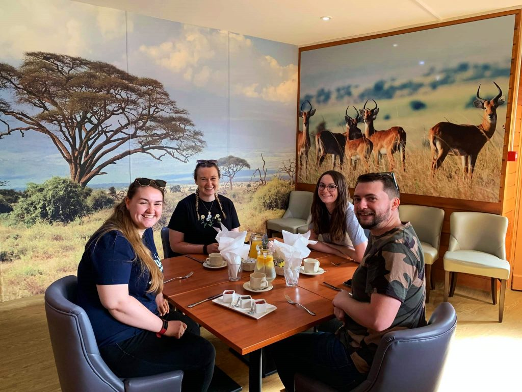 Group having breakfast in a private room on a Colchester Zoo extra-ordinary experience day.